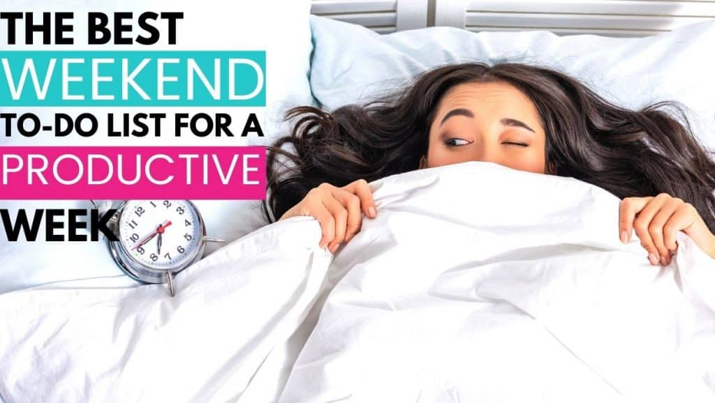 woman lying in bed looking at alarm clock; the best weekend to-do list for a productive week